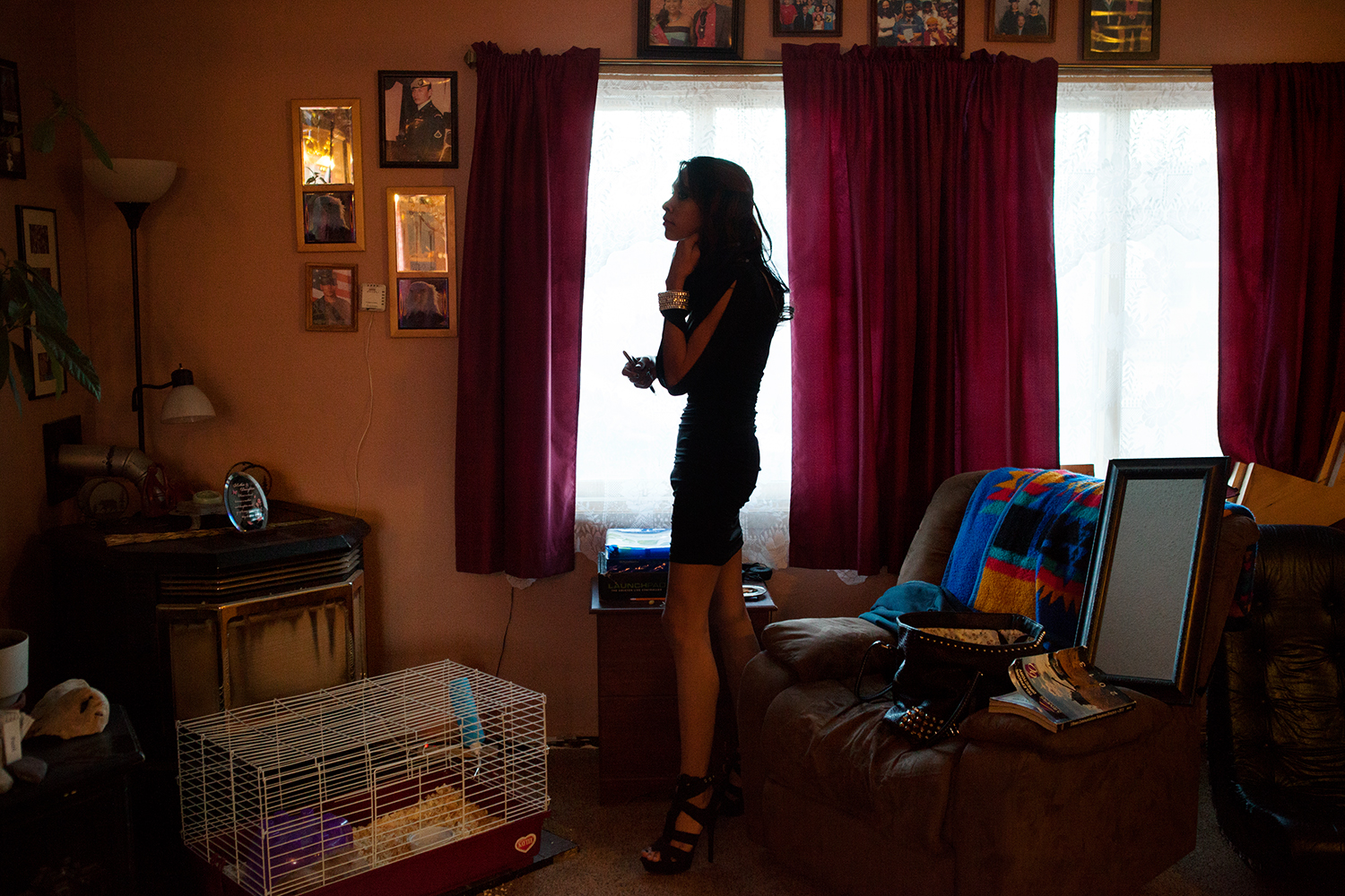 Dale standing in her living room wearing her prom dress.