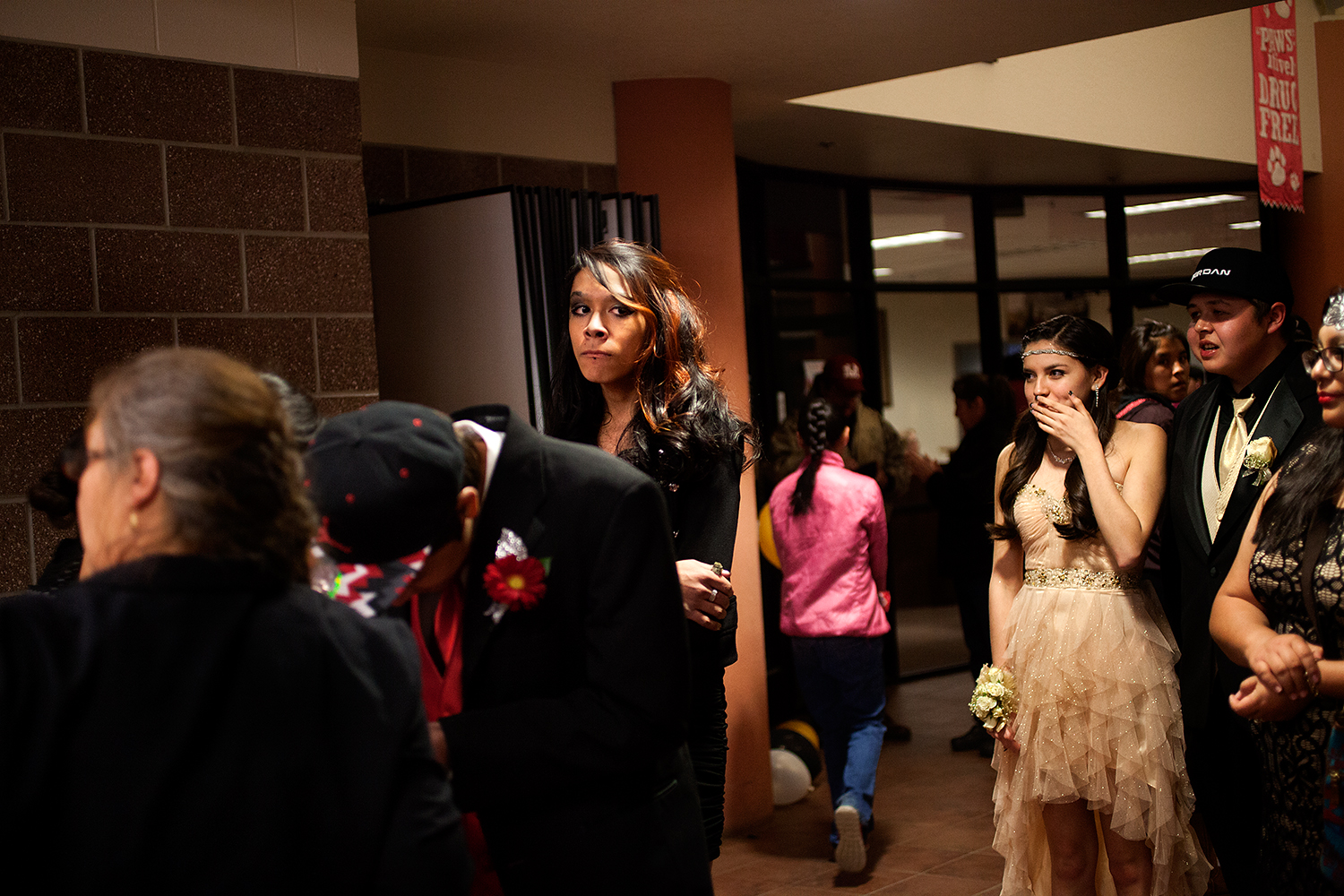 Dale waits in line with her peers to enter the prom.