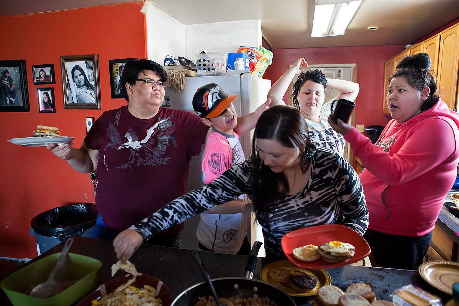 Dakota and his extended family talking and eating brunch in their kitchen.