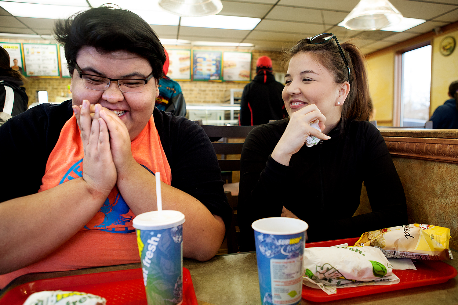 Dakota and his cousin, Kayla, laugh and eat at a Subway in Browning, Montana.